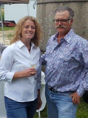 Christine and Terry Groth enjoy a moment during an annual farm dinner on their Farm 45 LLC.