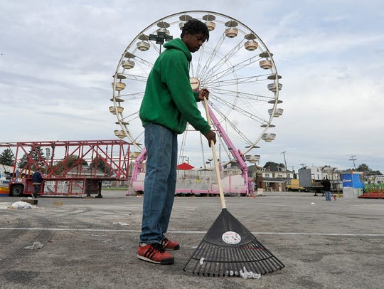 Jerron Thomas helps sweep up trash at the York Expo