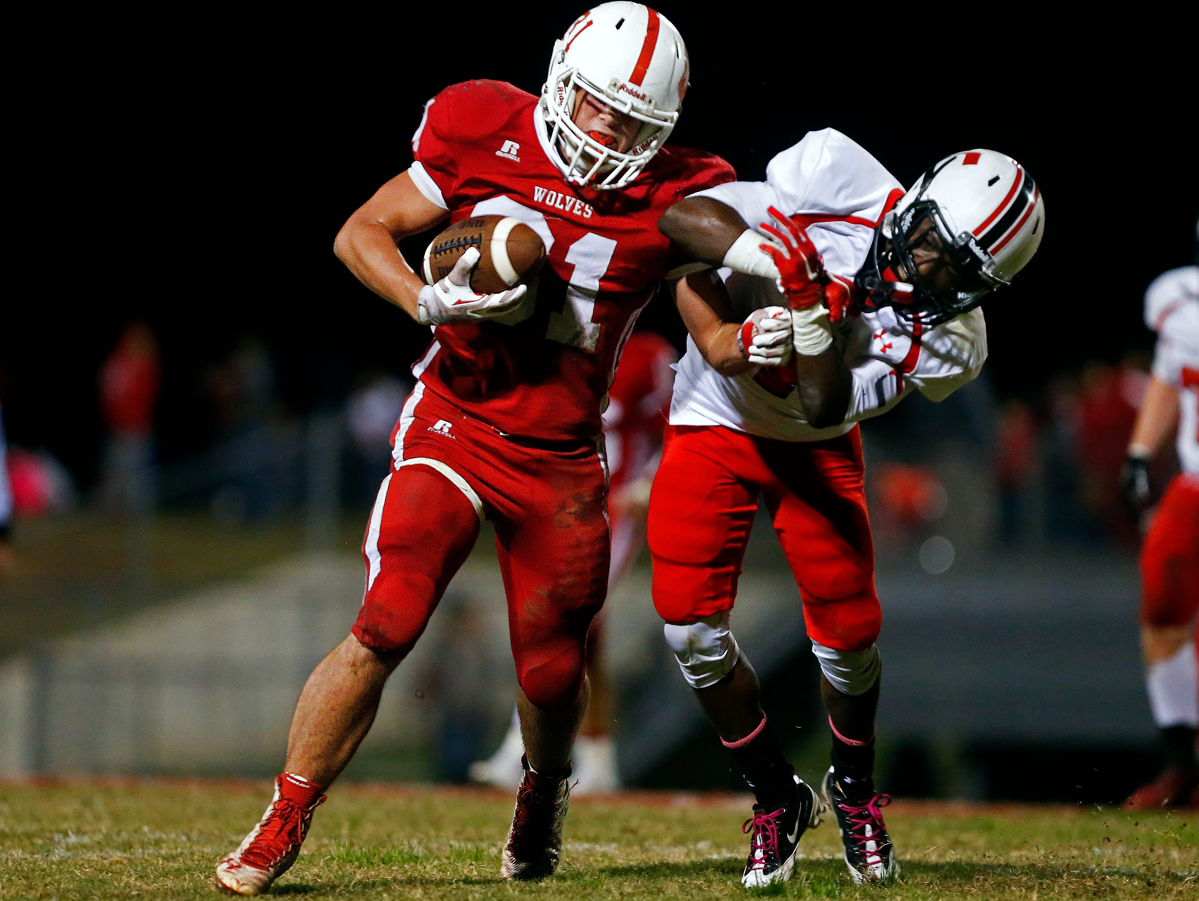 Reeds Spring High School fullback Colton Pomeroy (31) bounces off of a hard hit by Bulldogs defensive back Damarcus Mason (4) during second quarter action of the Wolves' game against Central High School at Carl Langley Field in Reeds Spring, Mo. on Oct. 9, 2015. Reeds Spring won the game 35-24.