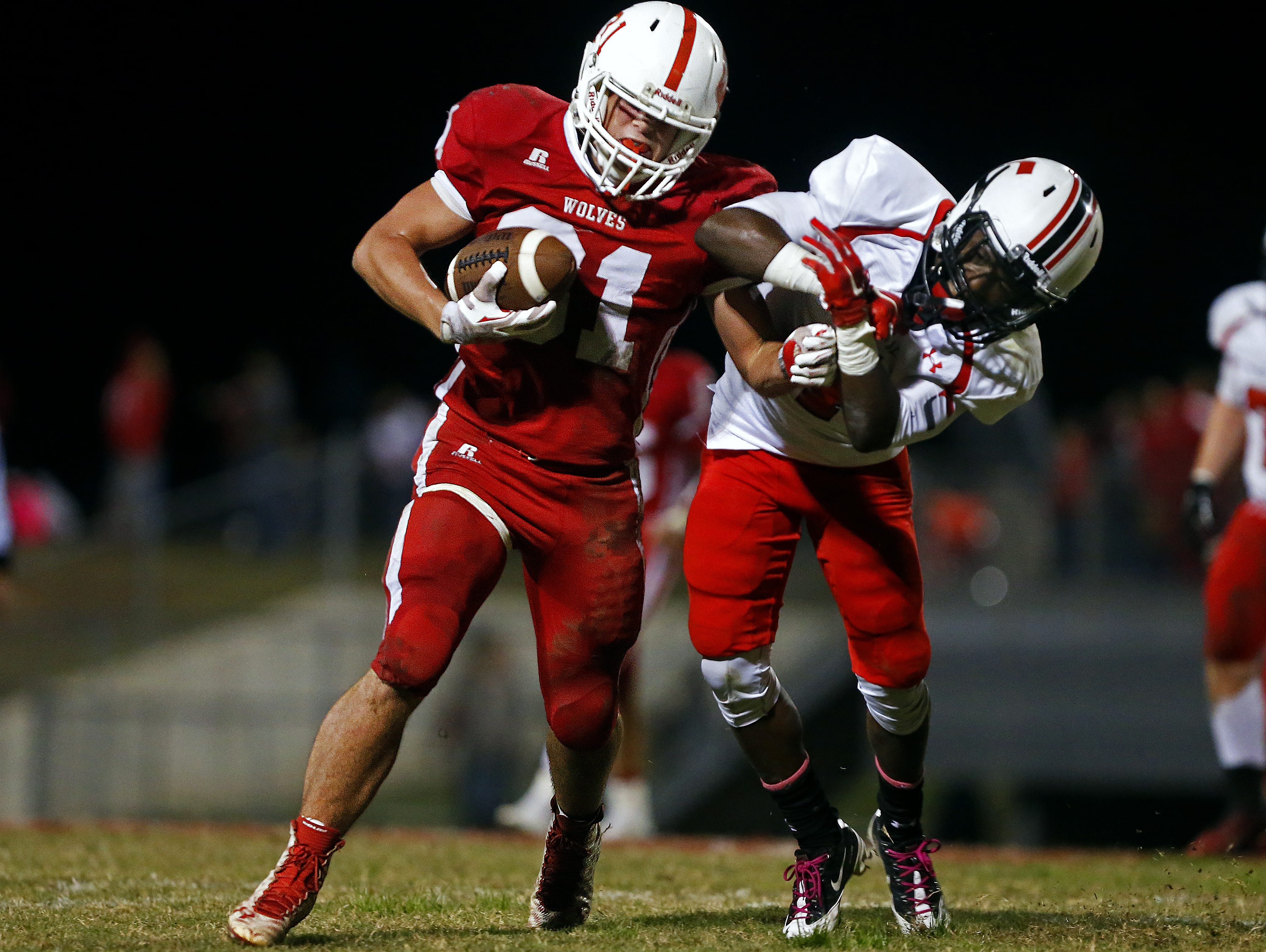 Reeds Spring High School fullback Colton Pomeroy (31) bounces off of a hard hit by Central Bulldogs defensive back Damarcus Mason (4) on Friday. Reeds Spring won the game 35-24.