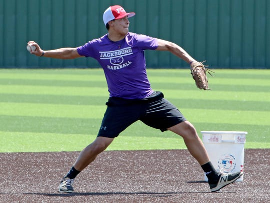 Jacksboro's Fernando Piedra throws to first during