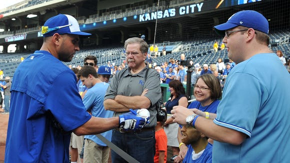 Royals second baseman Omar Infante signs autographs for fans before a game against the New York Yankees at Kauffman Stadium in May.