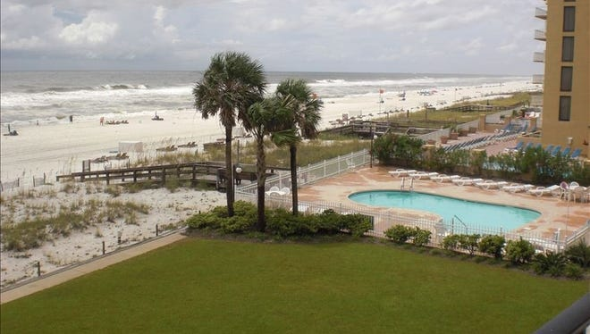 A condo on Orange Beach, Ala., advertised on VRBO. A new guest service fee raises the price of the rental by about 9%.