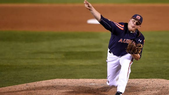 Auburn right-hander Justin Camp throws a complete game