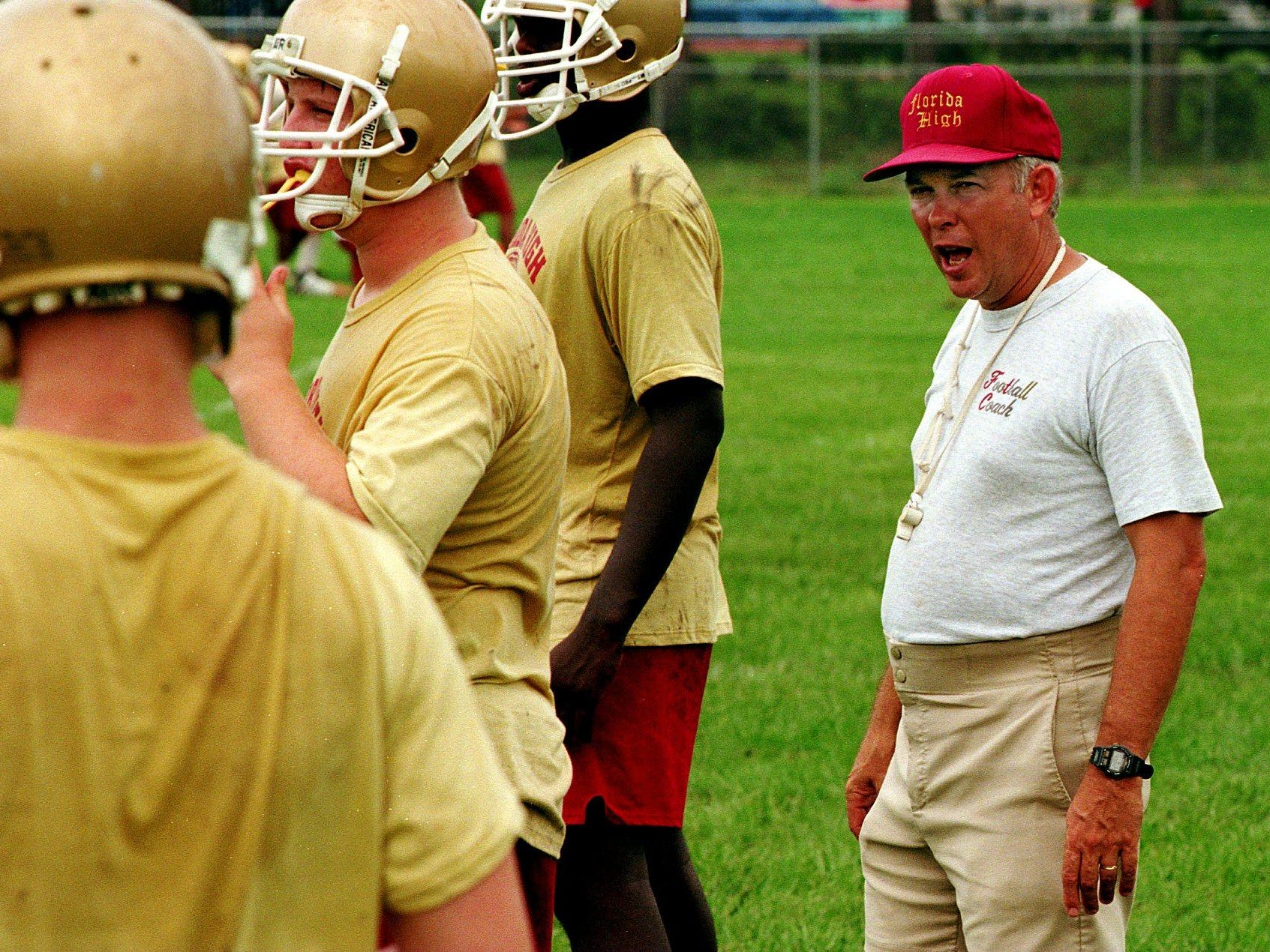 Mike Hickman coaches a football practice at an undetermined date prior to his retirement from coaching in 2006. Hickman became athletic director full-time. He's now retiring fully, and the Seminoles' football field was renamed in his honor for his 20 years of service to the school.