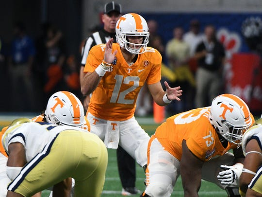 Vols quarterback Quinten Dormady (12) awaits the snap in the first half Monday, Sept. 4, 2017, against Georgia Tech.