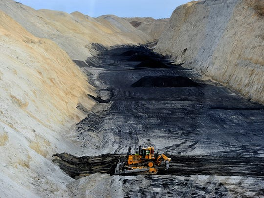 The uncovered coal seam at the Rosebud mine in Colstrip.  In this area the coal seam is 23 feet thick and about 180 feet below the serface.