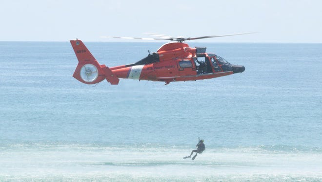 The U.S. Coast Guard holds demonstrations at Pensacola Beach on Friday, July 13, 2018, ahead of the Blue Angels Air Show.