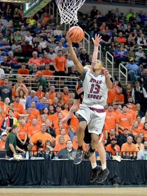 River Rouge's Darian Owens-White goes up for a shot against Ludington in Friday's Class B semifinal at the Breslin Center.