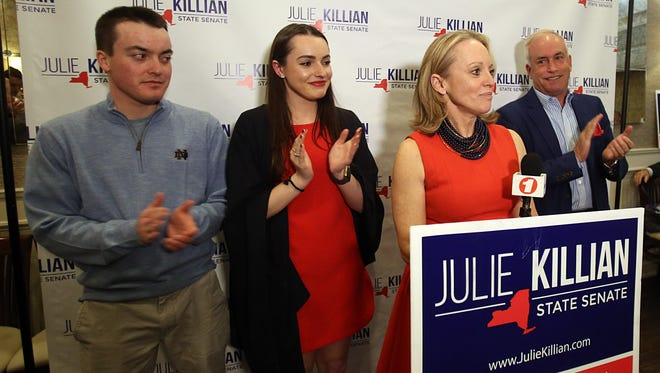 Republican Julie Killian, flanked by her family, thanks her supporters at Ciao in Eastchester after losing the race for the state Senate's 37th District on April 24.