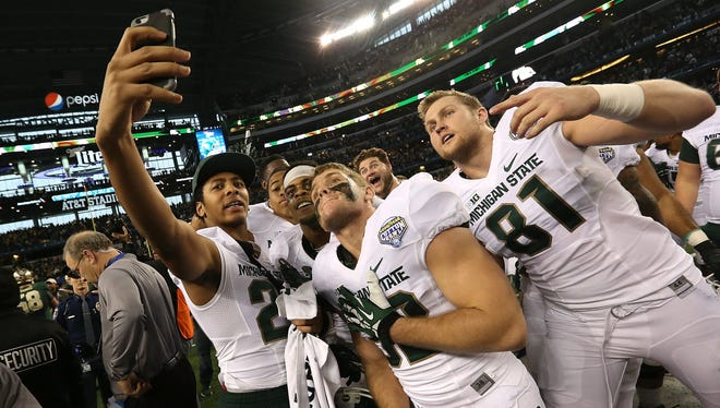 Spartans players take a team selfie after defeating the Baylor Bears during the Goodyear Cotton Bowl Classic.