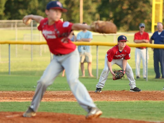 Benjamin Whitnell, first baseman, stares intently as pitcher Zach Tims throws to a South Nashville batter Thursday eve at Oakfield during the State Championship game for 11-12 year old Little League.