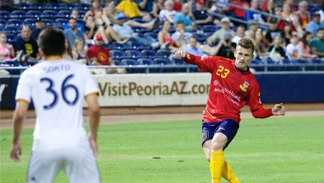Arizona United defender Scott Morrison hits a free kick in the 53rd minute of its game against LA Galaxy II on June 21, 2014 at the Peoria Sports Complex. The kick resulted in Morrison's first goal of the season.