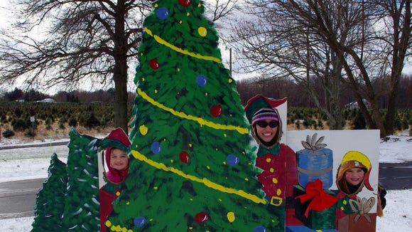 Stacey Milliman with her daughters Linley and Waverly at Wilbert's Tree Farm.