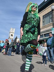 Jennifer Kacmarynski performs a traditional Irish dance step during last year's St. Patrick's Day parade in Sturgeon Bay.