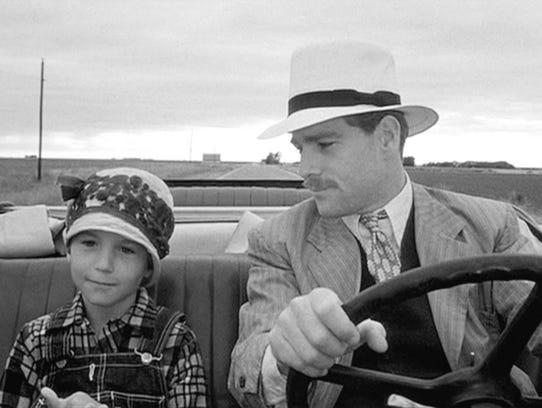 "Tatum and Ryan O'Neal in ""Paper Moon."""