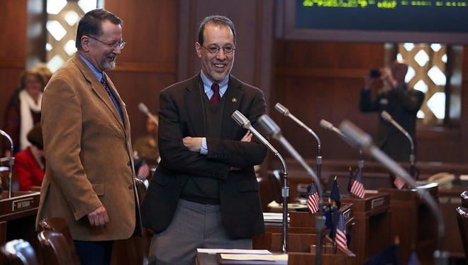 Sen. Fred Girod R-Stayton, left, and Sen. Michael Dembrow D-Portland chat on the Senate floor prior to the start of the the Oregon State Legislature's 2014 session Monday, Feb. 3, 2014.