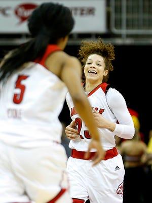 Louisville's Briahanna Jackson celebrates with teammate Taja Cole (#5) after knocking down a three. Jan. 28, 2016