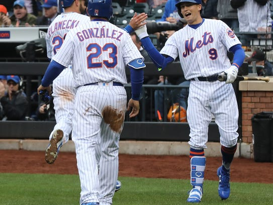 Kevin Plawecki and Adrian Gonzalez are greeted by Brandon