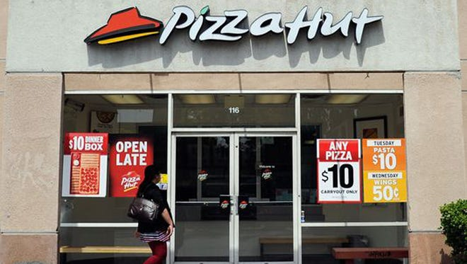 A customer walks in to a Pizza Hut restaurant in Los Angeles.