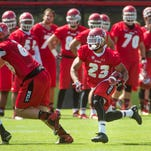 University of Utah running back Devontae Booker follows his blockers as he races up field during NCAA football camp, Thursday, Aug. 6, 2015 at the University of Utah in Salt Lake City.