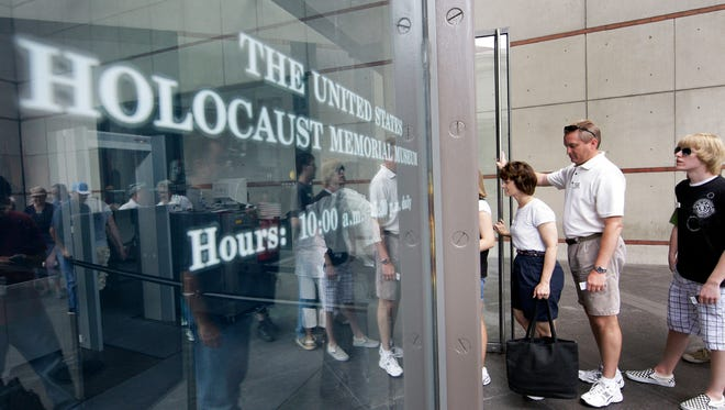 People line to enter the U.S. Holocaust Memorial Museum in Washington.