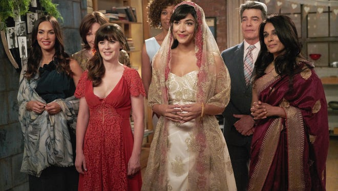 Wedding bells are ringing on 'New Girl,' with Megan Fox, left, Nora Dunn, Zooey Deschanel, Kim Wayans, Hannah Simone, Peter Gallagher and Anna George.