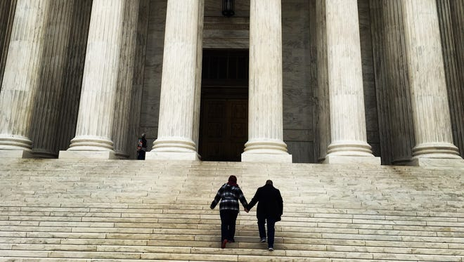April DeBoer, 44, left and Jayne Rowse, 50, climb the steps of the U.S. Supreme Court on Saturday April 25, 2015.