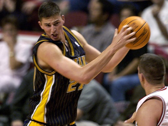 Indiana Pacers' Primoz Brezec left turns to shoot against pressure from Chicago Bulls' Brad Miller Saturday Oct. 20 2001 in Chicago.