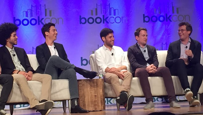 """Justice Smith, left, Nat Wolff, Michael H. Weber, Jake Schreier and John Green speak at the """"Paper Towns"""" panel at BookCon in New York Saturday."""