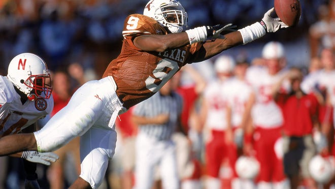 23 Oct 1999: Kwame Cavil #9 of the Texas Longhorns leaps to catch the ball during the game against the Nebraska Cornhuskers at the Texas Memorial Stadium in Austin, Texas. The Longhorns defeated the Cornhuskers 24-20. Mandatory Credit: Brian Bahr  /Allsport