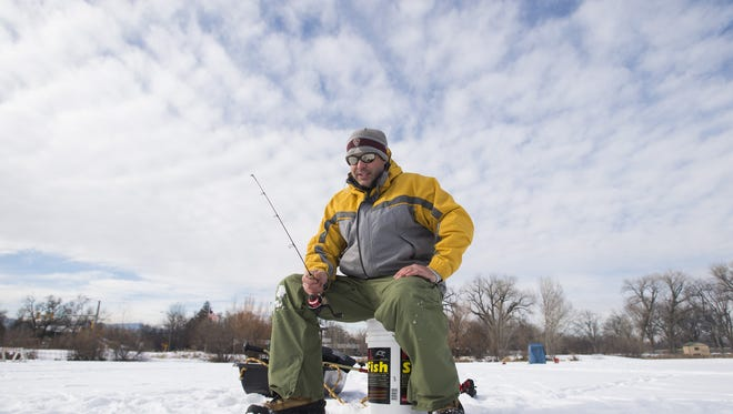 Matt Snider tries his luck ice fishing on Sheldon Lake at City Park in Fort Collins Tuesday, December 29, 2015.