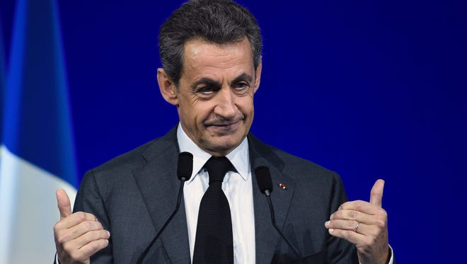 This file photo taken on February 13, 2016 shows former French president and Les Republicains (LR) right-wing main opposition party's leader Nicolas Sarkozy giving a speech during the LR National Council in Paris.