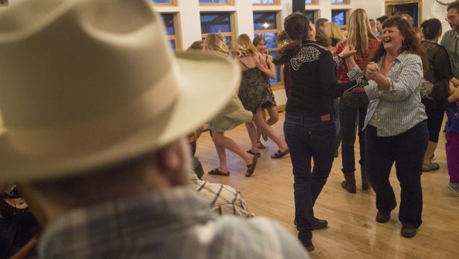 Participants try their best to follow dance instructions during a barn dance at Wolverine Farm Letterpress and Publick House on Saturday, March 25, 2017. The Central Rockies Old-Time Music Association hosts a barn dance every month at locations around Fort Collins.