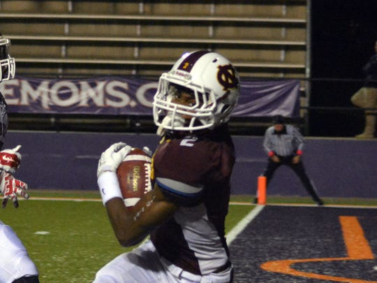 Natchitoches Central's Darian Raymond (2, right) falls into the end zone ahead of Pineville's Jarious Green (5, left).