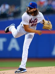 Mets starting pitcher Robert Gsellman (65) pitches