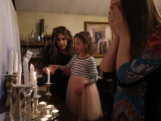 Bassie Friedman helps her daughter Devorah Leah Friedman,