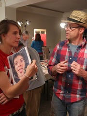 Workshop founder David Anthony Hummer works with Wausau West senior Teressa Baumann on her painting of her brother at The Bauhaus in downtown Wausau.