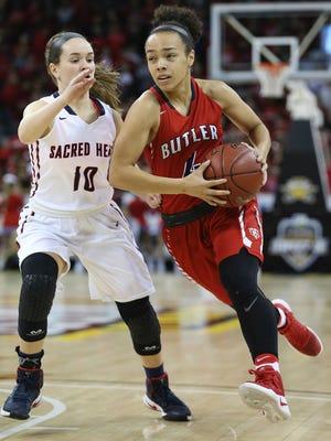 Butler's Tasia Jeffries drives on Sacred Heart's Kiki Samsel during the first half.
