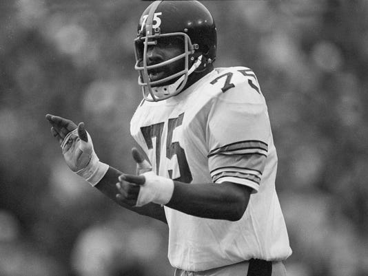 "FILE - In this Jan. 13, 1975,  file photo, Pittsburgh Steelers' tackle ""Mean"" Joe Greene encourages his teammates during  the Super Bowl game against the Minnesota Vikings at Tulane Stadium in New Orleans. Greene was selected to the Super Bowl 50 Golden Team, Thursday, Jan. 28, 2016.  (AP Photo/Harry Cabluck, File)"