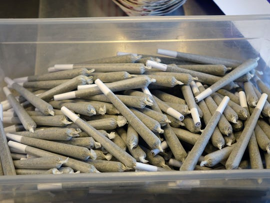 A box of joints awaits customers at the Harborside Health Center in Oakland, Calif.