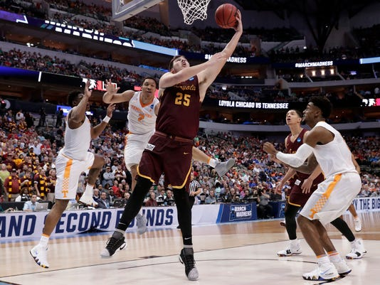 Loyola-Chicago center Cameron Krutwig (25) shoots after getting past Loyola-Chicago's Marques Townes, left, and Jake Baughman (2) during the second half of a second-round game at the NCAA men's college basketball tournament in Dallas, Saturday, March 17, 2018. (AP Photo/Tony Gutierrez)