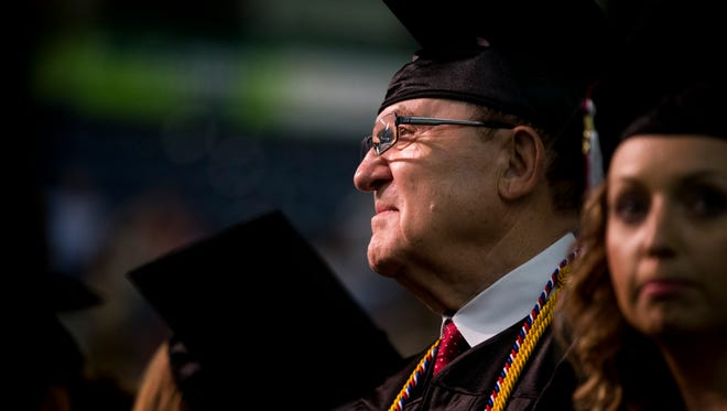 Nic Neumann, 77, along with 400-plus other graduates, waits for his name to be called to officially receive his Bachelor's in Science for Management degree from Hodges University at Germain Arena, now known as Hertz Arena, Sunday, June 11, 2017 in Estero.