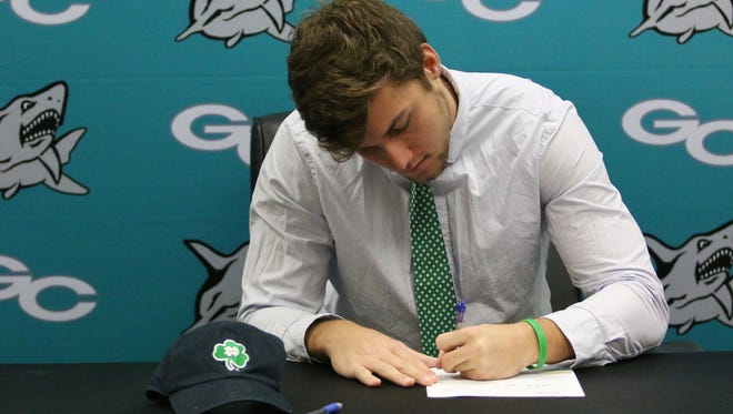 Gulf Coast tight end George Takacs takes advantage of the early signing period and makes it official with Notre Dame during an intimate ceremony at Gulf Coast High School on Wednesday.