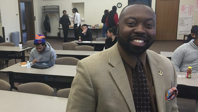 Lomax Campbell, assistant to the vice president at Monroe Community College, speaks to students in Operation Transformation Rochester's Fresh Start program on March 14. He also started his own marketing and management consulting business, Third Eye Network LLC.