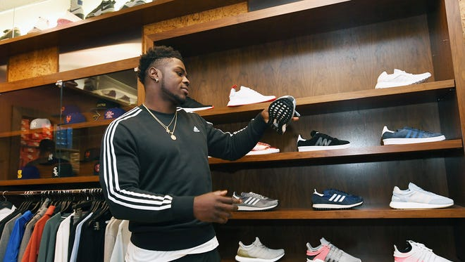 Jabrill Peppers, former Paramus Catholic football star who will soon be drafted into the NFL, looks at sneakers at Packer Shoes in Teaneck on Saturday, April 22, 2017.