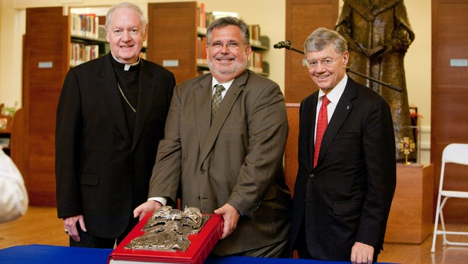 From left, Edward Cardinal Egan, Archbishop Emeritus of New York; Dean Emeritus and Professor Eugene R. Milhizer of the Ave Maria School of Law and Thomas Monoghan, chairman of the board and founder of Ave Maria School of Law.
