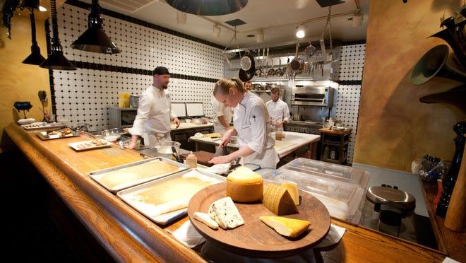Chefs work at Joseph Decuis.