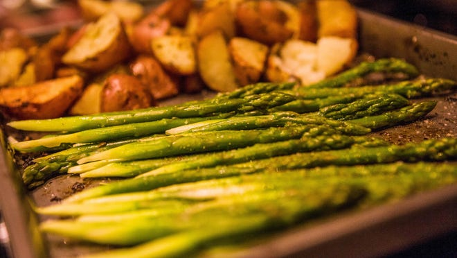 My new favorite recipe for roasting vegetables: olive oil, garlic, salt, pepper and citrus zest. Works well with fresh vegetables and potatoes.
