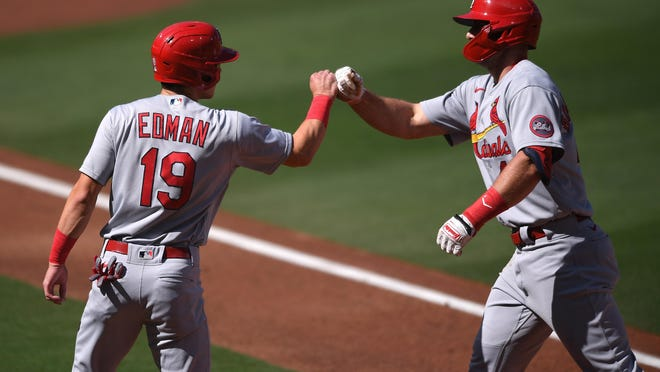 St. Louis Cardinals first baseman Paul Goldschmidt, right, is congratulated by third baseman Tommy Edman (19) after hitting a two-run home run against the San Diego Padres on Wednesday at Petco Park in San Diego.